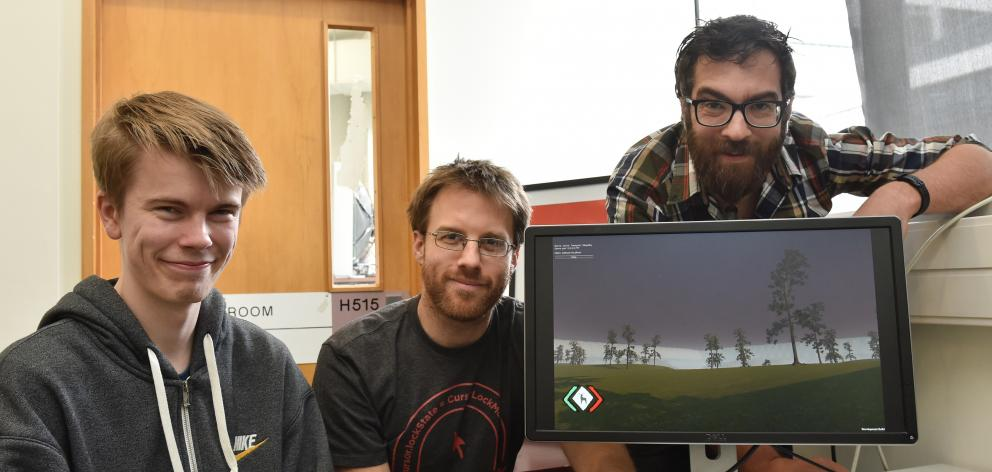 Polytechnic student Mitchell Briggs (left), lecturer Adon Moskal and technology specialist Hugh Harlow check out a pre-release version of Forth Street Studio's survival game, SKIN. Mr Briggs said he spent four months working on the game. Photo: Gregor Ric