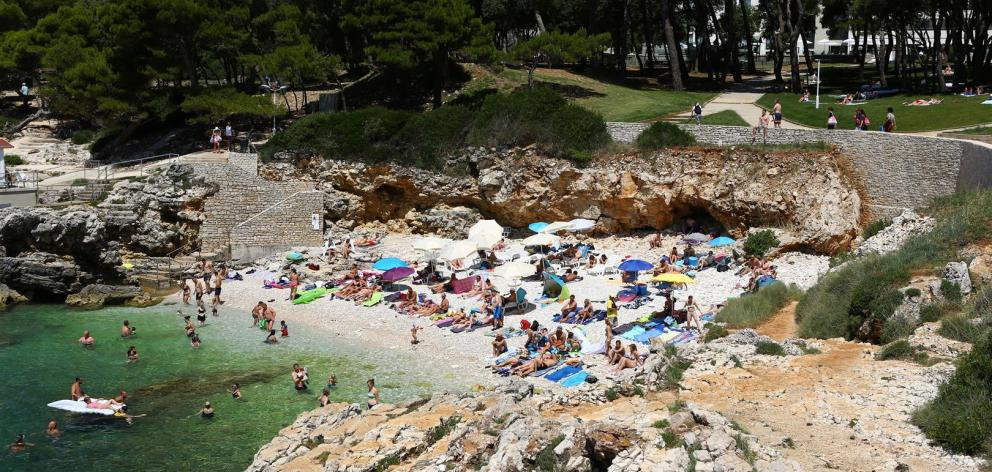 The so-called Hawaii Beach in Pula, Croatia, in summertime. Photos: Getty Images.