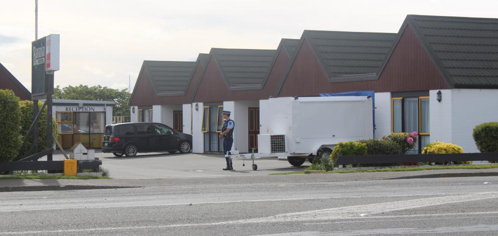 Police guard the scene at the Bavarian Motel after the body was found. PHOTO: ABBEY PALMER
