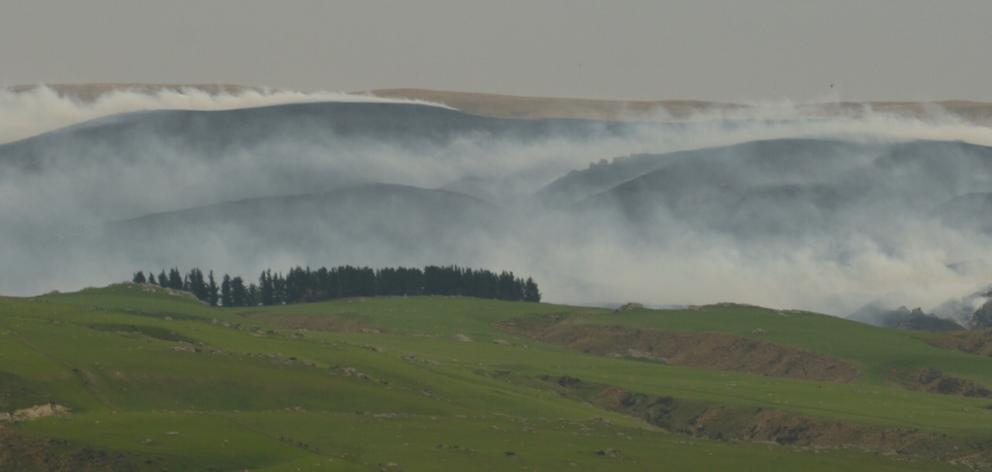 A large area of tussock burning in Te Papanui Conservation Park, near Middlemarch. Photo: Gerard...