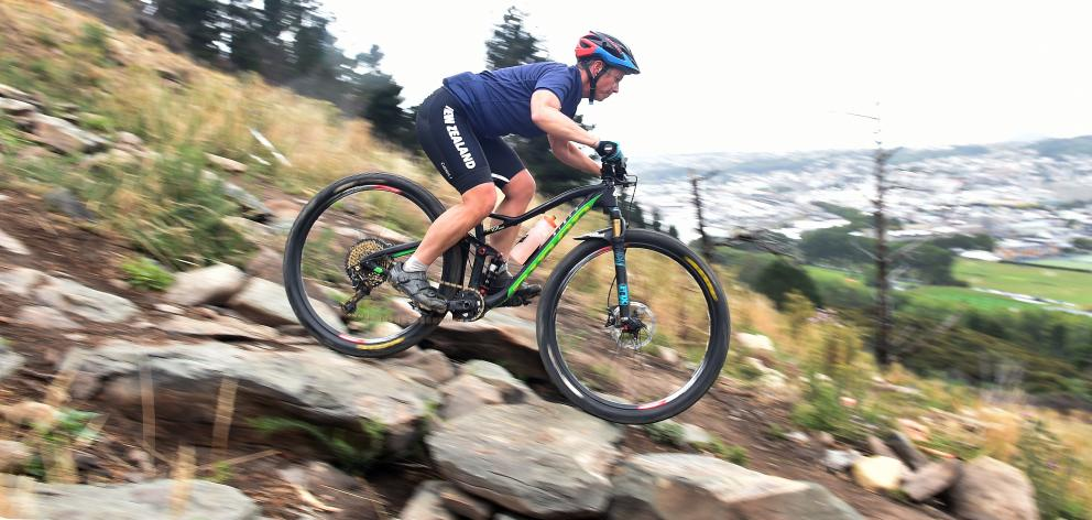 Mountain bike rider Ronel Cook negotiates part of the cross-country track at Signal Hill...