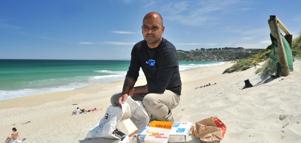 Our Seas Our Future founder Noel Jhinku collects litter at St Kilda Beach yesterday. PHOTO:...