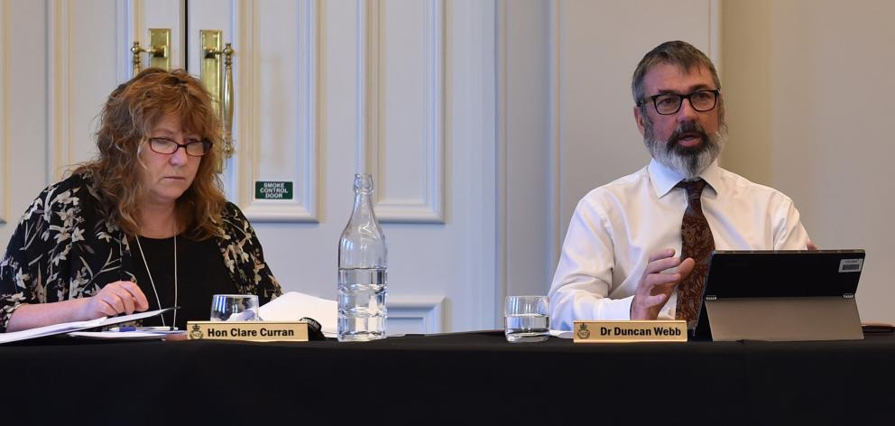 MPs Clare Curran and Duncan Webb listen intently to select committee submissions on the Arms...