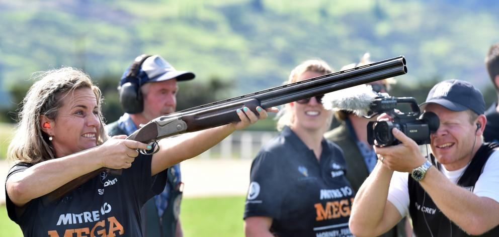 Tracey Dulieu, of Christchurch, takes part in clay target shooting during filming of  New Zealand...