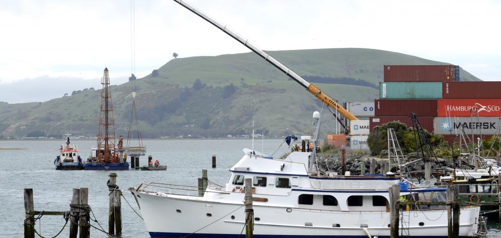 A 250-tonne Titan crane lowers the first section of a new fishing jetty into position at Boiler Point, Port Chalmers, yesterday. Photo: Gerard O'Brien