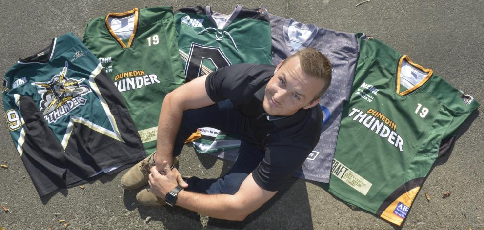 Dunedin Thunder stalwart (and Ice Black) Regan Wilson, with his collection of Thunder jerseys....