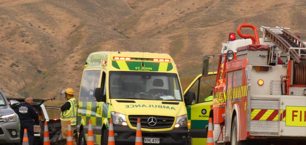 Emergency services at the scene after a car rolled on Omakau-Chatto Creek Rd this morning. Photo: Adam Burns