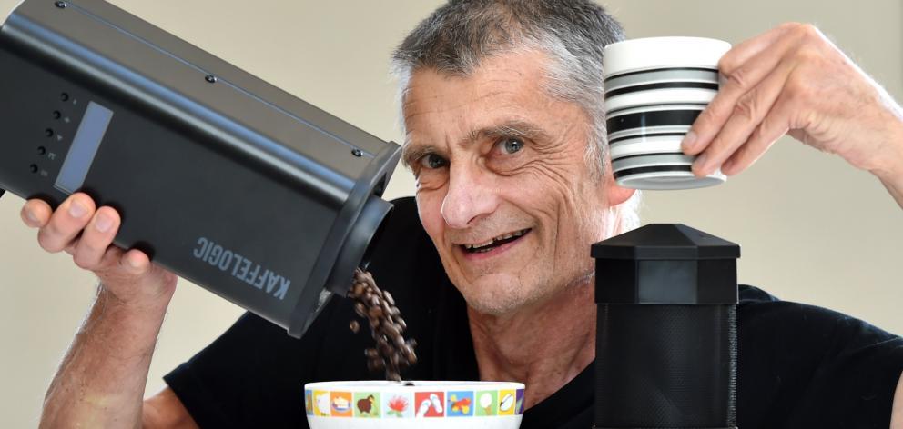 Dunedin inventor Chris Hilder shows off his Kaffelogic bean roasting device. PHOTO: PETER MCINTOSH