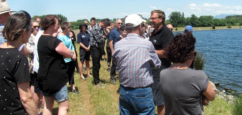 Chris Allen addresses teachers alongside the 150,000cu m water storage pond on his farm at Ashburton Forks. Photos: Toni Williams