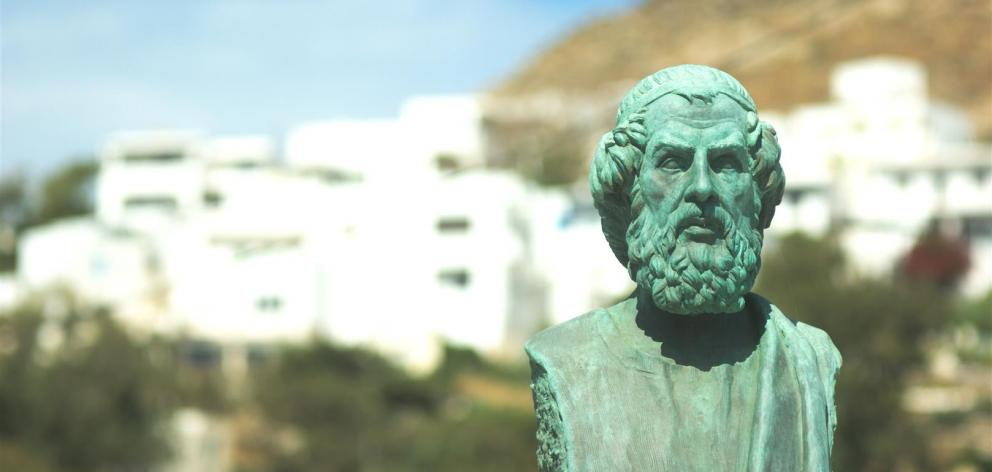 A harbourside bust of Homer in the Greek holiday island of Ios.
