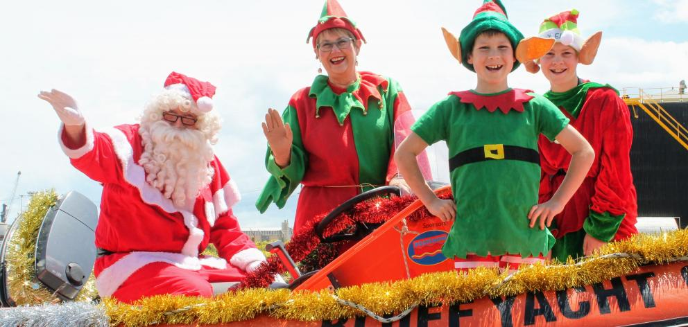 Ho! Ho! Ho! Santa Claus Paul Potter, Gaylyn Potter and elves Clark (8) and Angus (10) Manson in...