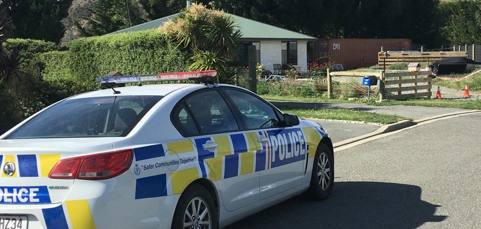 A police car at the cordoned Freyberg Ave property in Kurow where a man was shot dead by police...