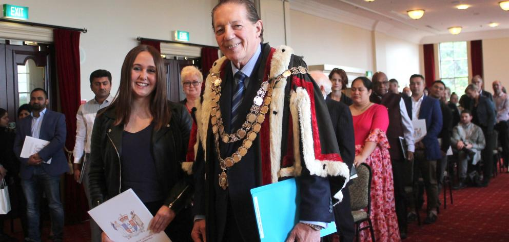 Invercargill reporter Laura Smith received her New Zealand citizenship certificate from Mayor Tim...