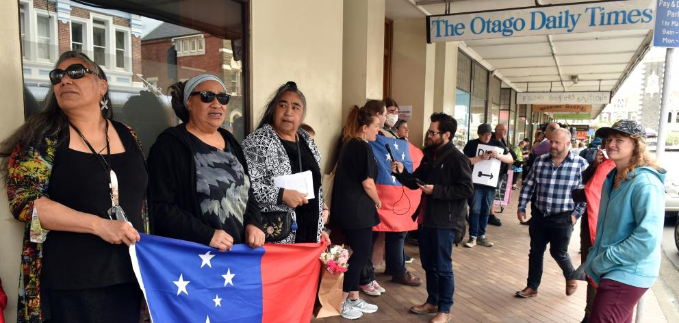 Protesters opposed to the publication of a Garrick Tremain cartoon gather outside the Otago Daily...