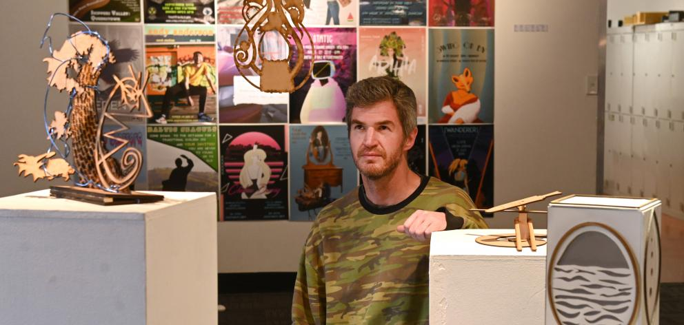 Otago Polytechnic School of Design senior lecturer Morgan Oliver with a display of his students' work. Photo: Linda Robertson