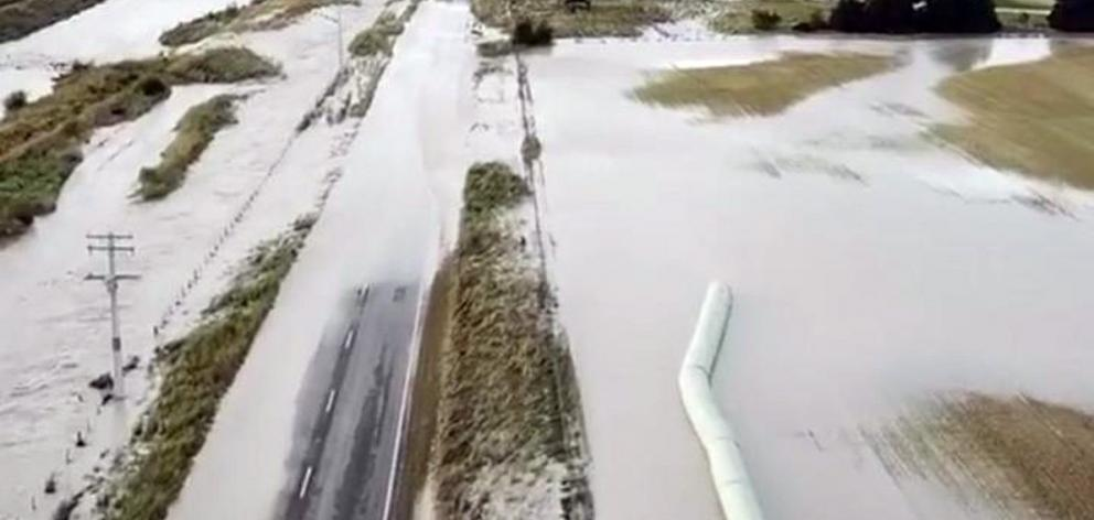 The lower half of the South Island was cut off after the Rangitata River broke its banks and...