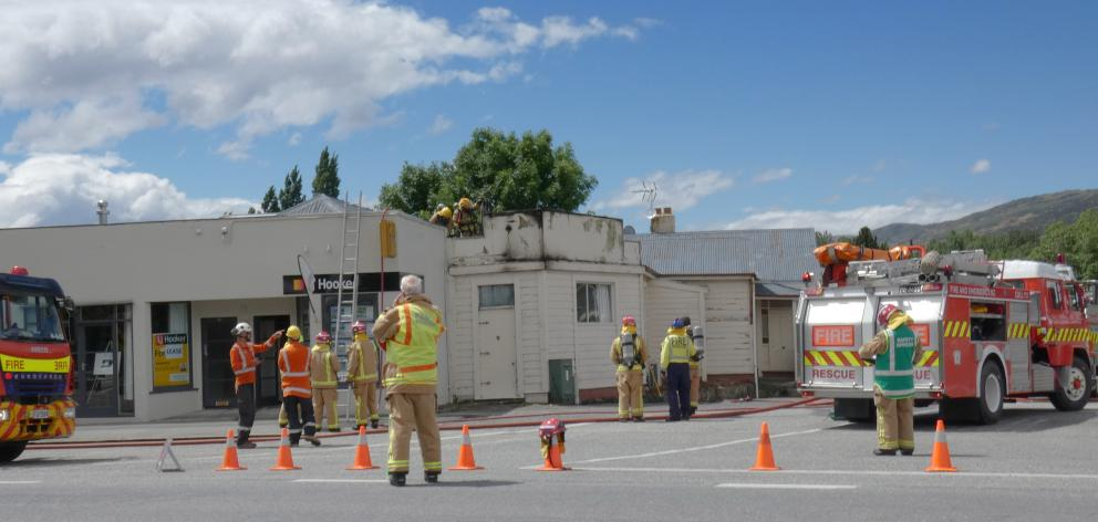 Emergency services work at a fire in Roxburgh yesterday. PHOTO: SIMON HENDERSON