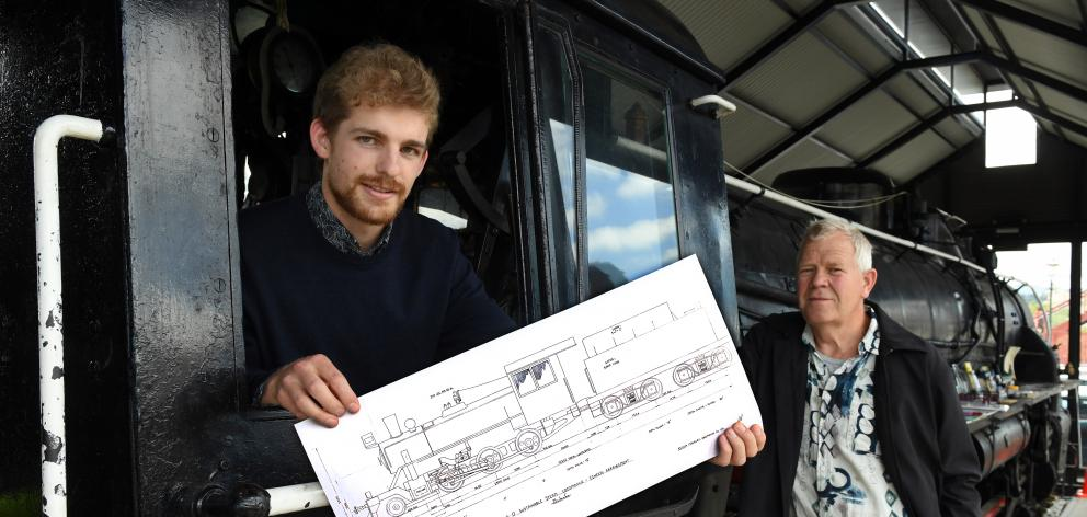Sam Mackwell (left) and Nico Haima, of Christchurch firm Mackwell Locomotive Ltd, with plans for a wood-powered steam locomotive they hope will see machines like JA 1274, now based at Toitu Otago Settlers Museum, return to the rails. Photo: Stephen Jaquie