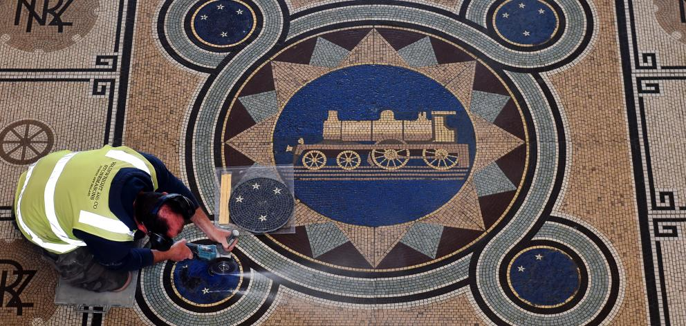 Wainwright & Co foreman Donal Hickey was preparing to start work on restoring mosaics in Dunedin Railway Station last night. Photo: Peter McIntosh