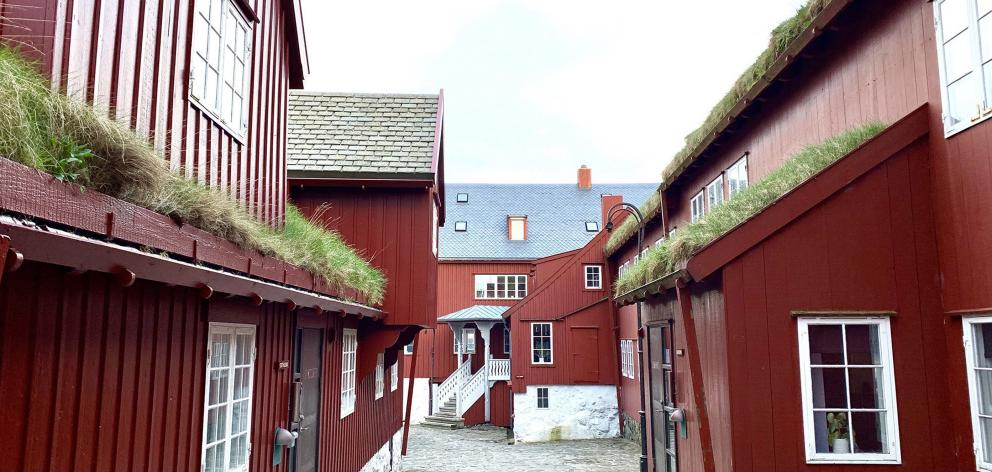 Tinganes, a historic area in Torshavn, the capital of the Faroe Islands, has red government...
