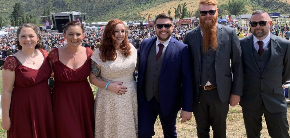 Newlyweds Rebecca and Alan Menzies are flanked by (from left) bridesmaids Amber Hosking and Jamie...
