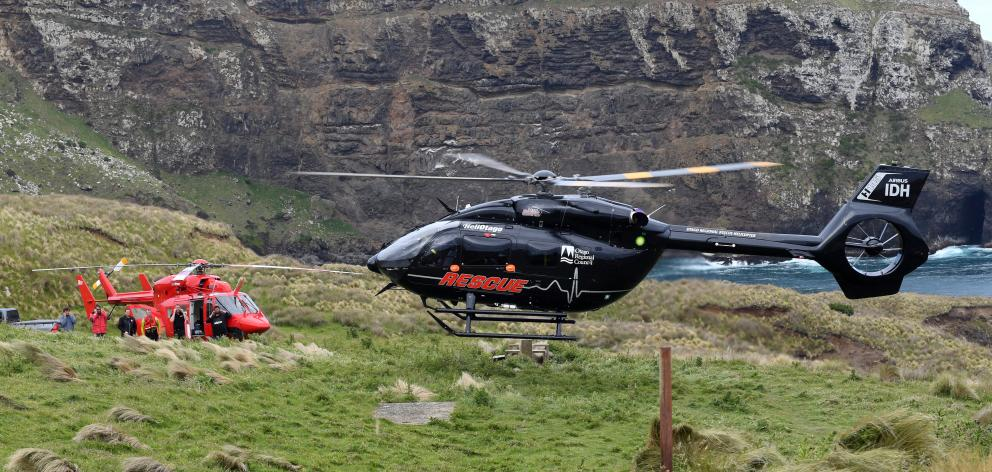 Otago Rescue helicopters at the scene of an incident at Cape Saunders today. Photo: Stephen...