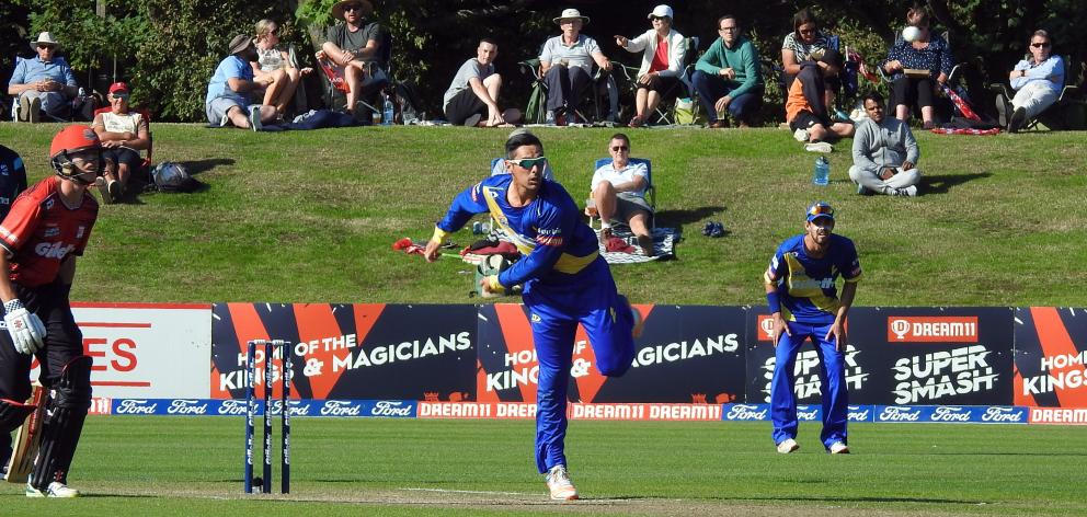 Otago all-rounder Anaru Kitchen bowls during his side Super Smash twenty20 match at the Hagley Oval in Christchurch yesterday. Michael Rippon looks on. Photo: Supplied