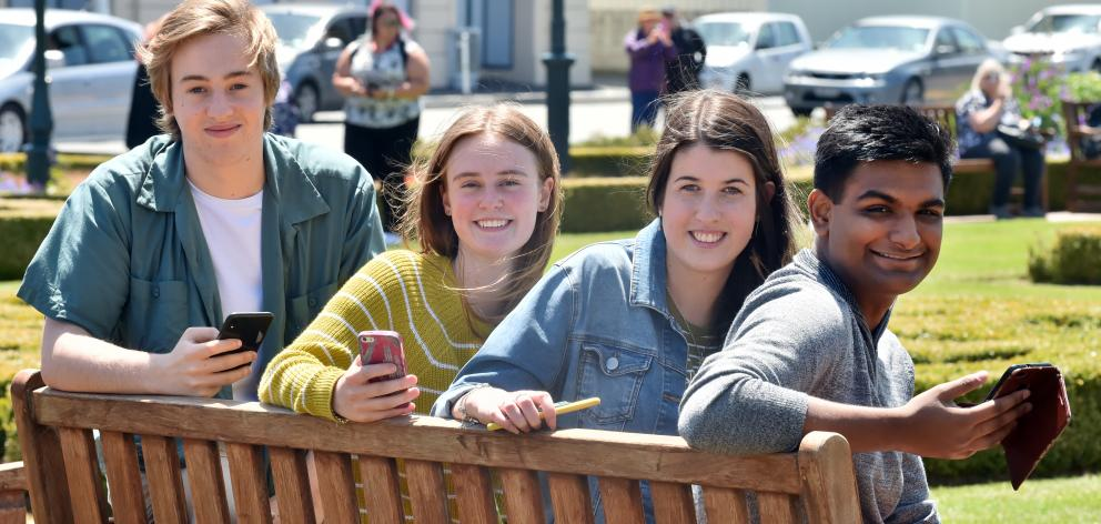 Former Kaikorai Valley College year 13 pupils (from left) Cayden Scott, Class Act award recipient Amanda Fiveash, Tessa Willis and Prashant Prasad (all 18) reflect on their NCEA results, near the Dunedin Railway Station, yesterday. Photo: Gerard O'Brien