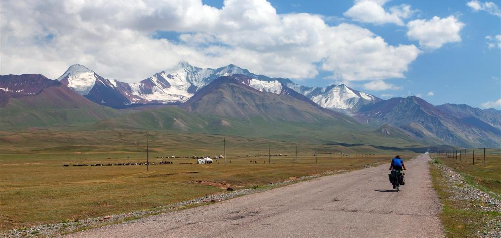 A cyclist makes his way along the Pamir highway in Kyrgyzstan.
