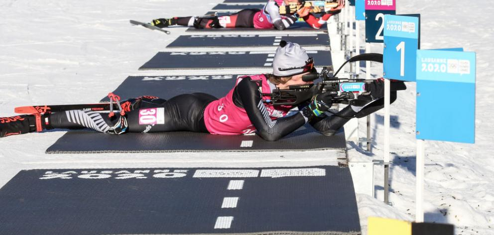 Campbell Wright, of Hawea Flat, shoots and skis in the men's 7.5km sprint biathlon at the Youth Winter Olympics in Lausanne, France, yesterday. Wright finished fourth to go with his earlier sixth in the 12.5km event. Photos: Getty Images