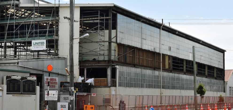 Contractors remove cladding from the Hillside workshop building