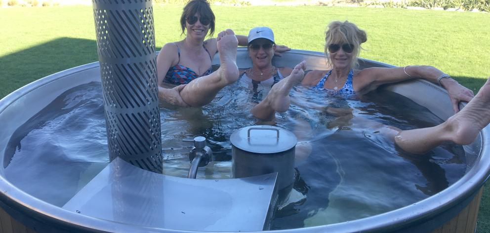 Relaxing in the hot tub at Lake Ohau Quarters, after a full day cycling.