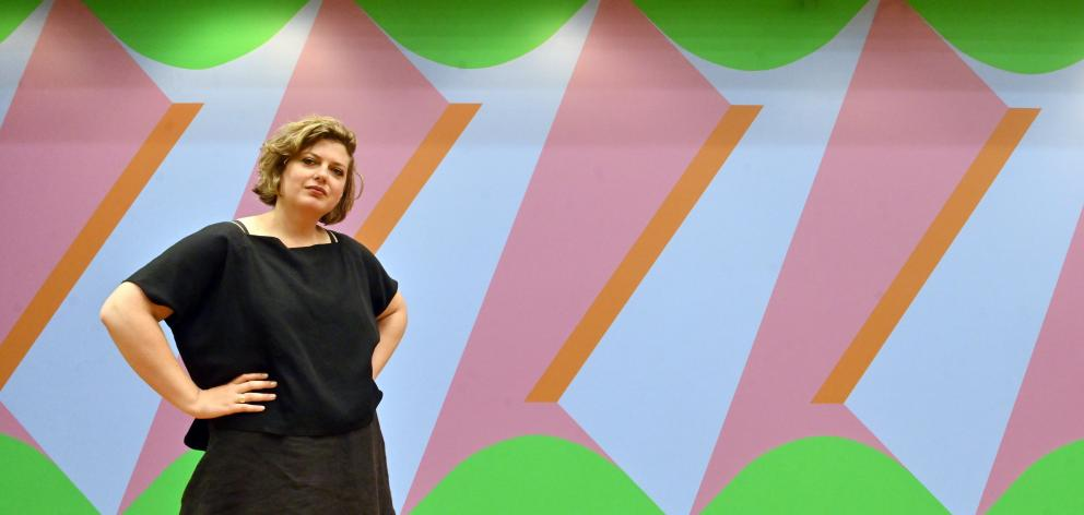 Frances Hodgkins Fellow Imogen Taylor poses in front of Double Portrait: Screw Thread from her ''Sapphic Fragments'' exhibition at the Hocken Library. Photo: Linda Robertson