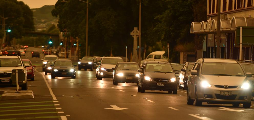 It was dark enough in Dunedin that motorists had to drive with their lights on. Photo: Gregor...