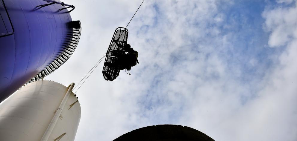 Dunedin senior firefighter Joe Begley is lowered from a silo at the former Cadbury premises...