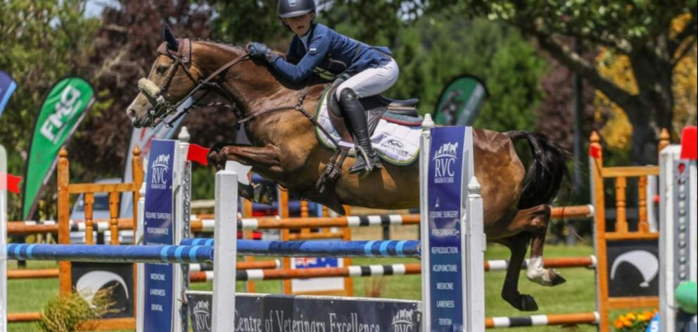 Emma Gillies takes Benrose Playtime over a jump on the way to victory. Photo: Sophie Simpson Photography