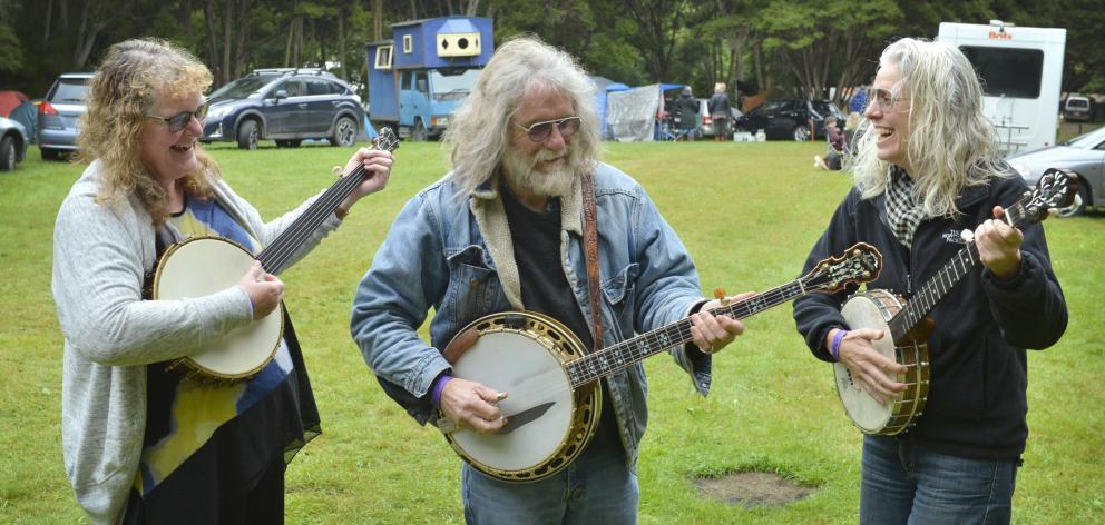 Enjoying a jam session on their banjos at the Whare Flat Folk Festival yesterday were (from left) Monica Barkman, Robbie Stevens and Carola Dunbar, all of Dunedin. Photos: Gerard O'Brien