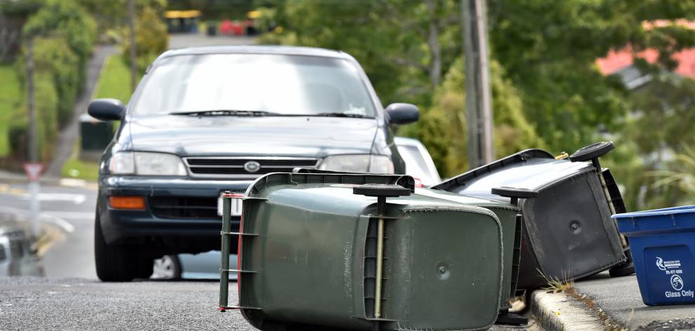 Strong winds knocked over wheelie bins in Forth St, North Dunedin, on Saturday.