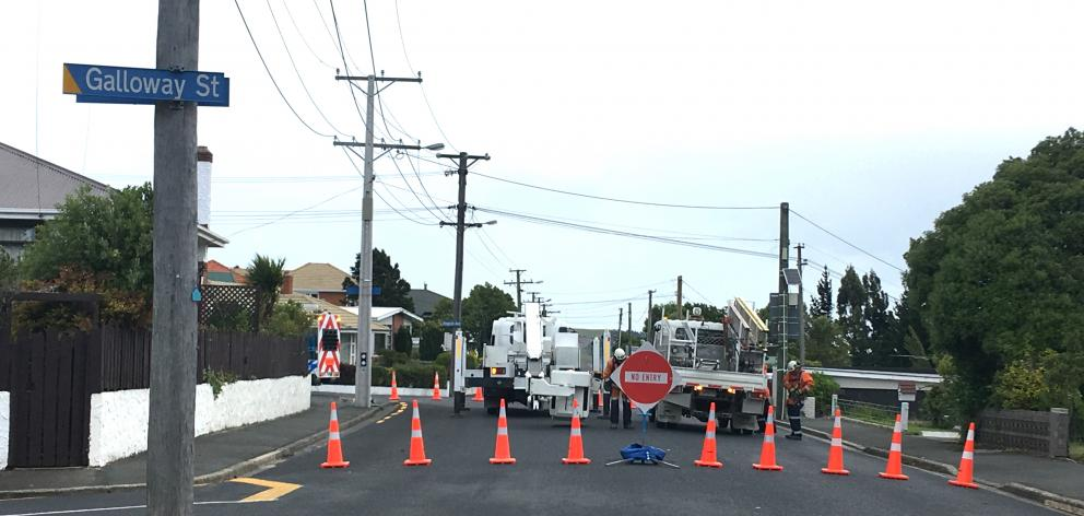 Kenmure Rd was closed while linesmen went to work to fix power lines this evening. Photo:...