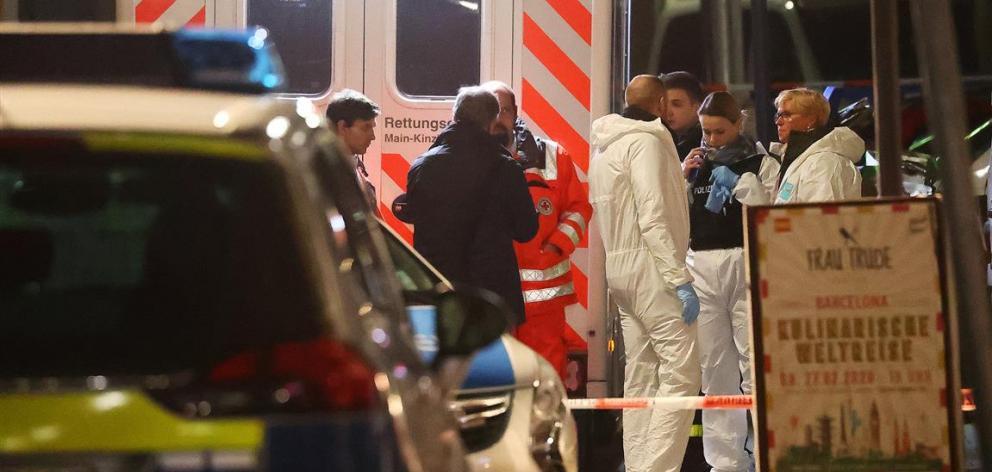 Forensic experts at work outside a shisha bar in Hanau following the shooting. Photo: Reuters