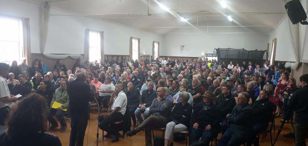 Gore Mayor Tracy Hicks talks to the 400-strong crowd at the Mataura Youth Trust Hall last night....