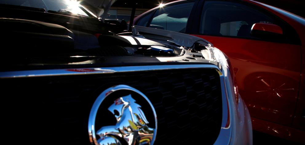 Holden cars are pictured at a dealership located in Perth. General Motors has announced it will wind down operations in Australia and New Zealand and retire the Holden brand as part of a retreat from unprofitable markets. Photo: Reuters