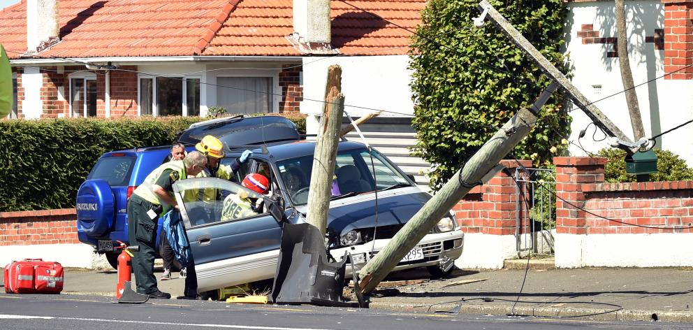 A car hit a power pole on Taieri Rd about midday. Photo: Peter McIntosh