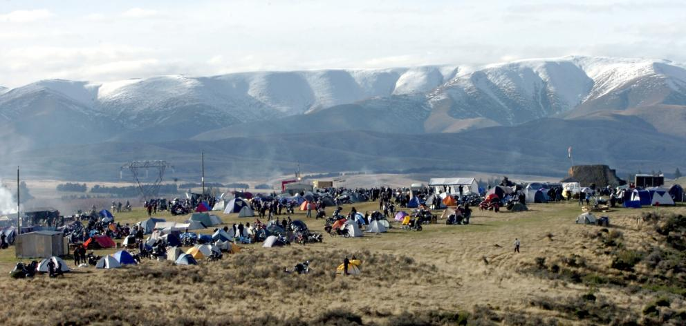 The snow-covered Hawkdun Range rises above the Brass Monkey Rally camp at Idaburn dam, near...