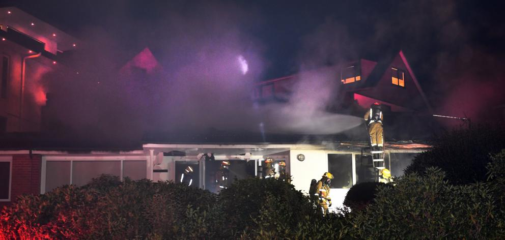 Fire crews at the scene of the house fire in Challis St. Photo: Stephen Jaquiery