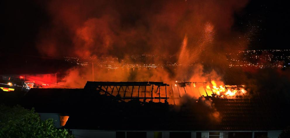 A large fire tore through this Challis St house about 3am yesterday, leaving its occupant dead. Photos: Stephen Jaquiery