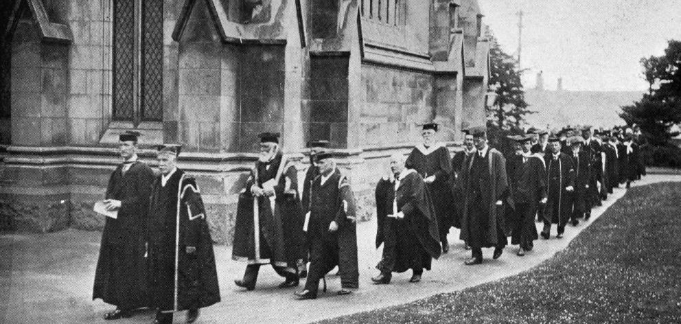 Academic staff in procession for the University of Otago's jubilee function. At the head is the Chancellor, (Rev Dr Cameron) and Professor G. E. Thompson, with the Chief Justice, Sir R. Stout, following. — Otago Witness, 10.2.1920.
