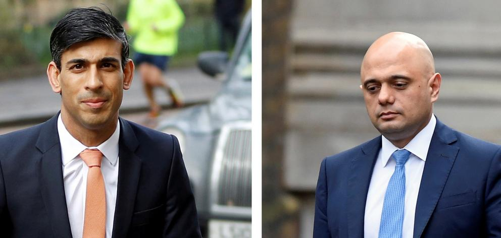 Newly appointed Britain's Chancellor of the Exchequer Rishi Sunak (left) replaces Sajid Javid....