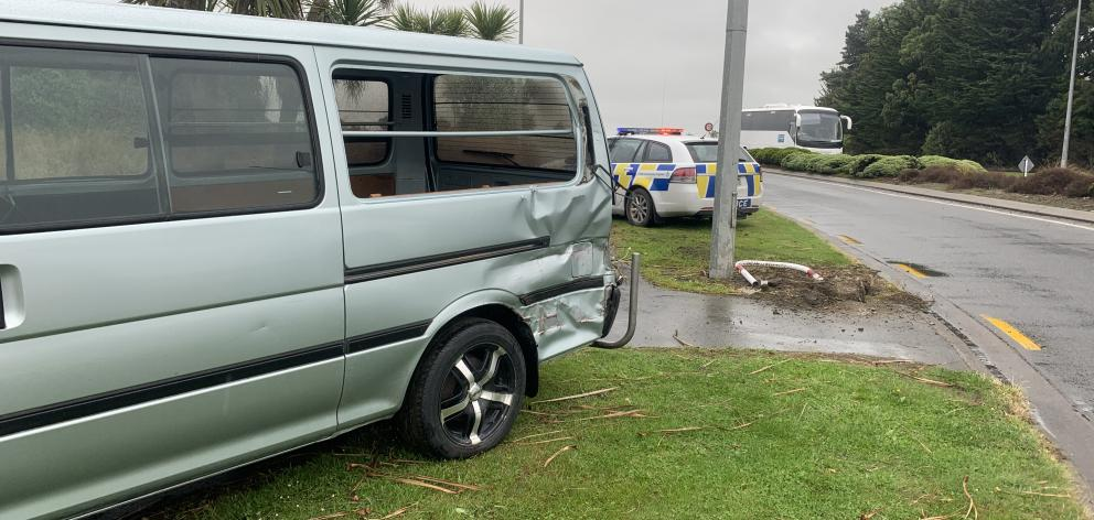 Multiple police vehicles attended the scene of a crash involving a car, truck and pole near the Stead St roundabout in Invercargill yesterday. Photo: Abbey Palmer