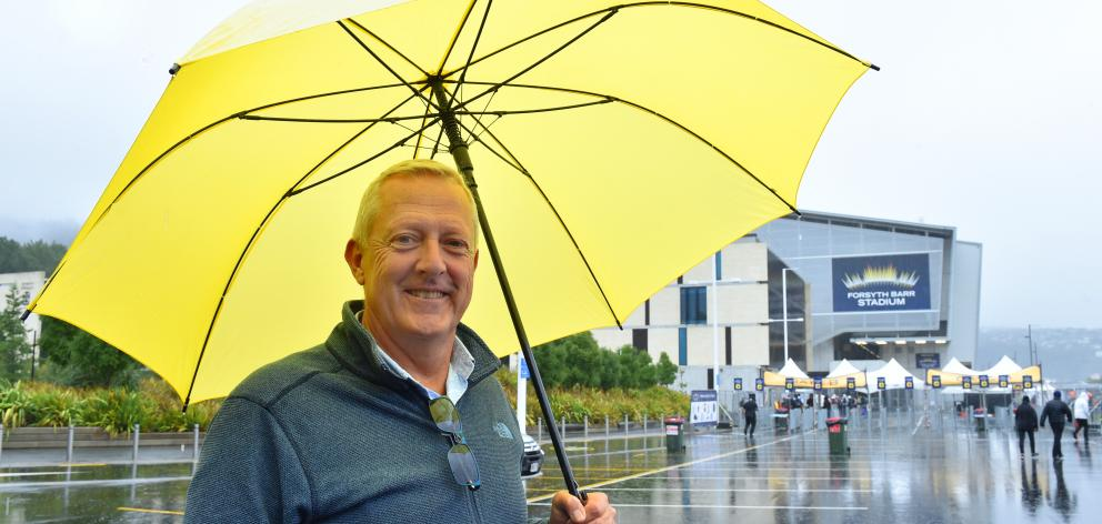 A ''tiny bit of rain'' could not keep James Vaughan from attending last night's Elton John concert at the stadium, which is named after his great-uncle Robert Forsyth Barr. Photo: Gregor Richardson